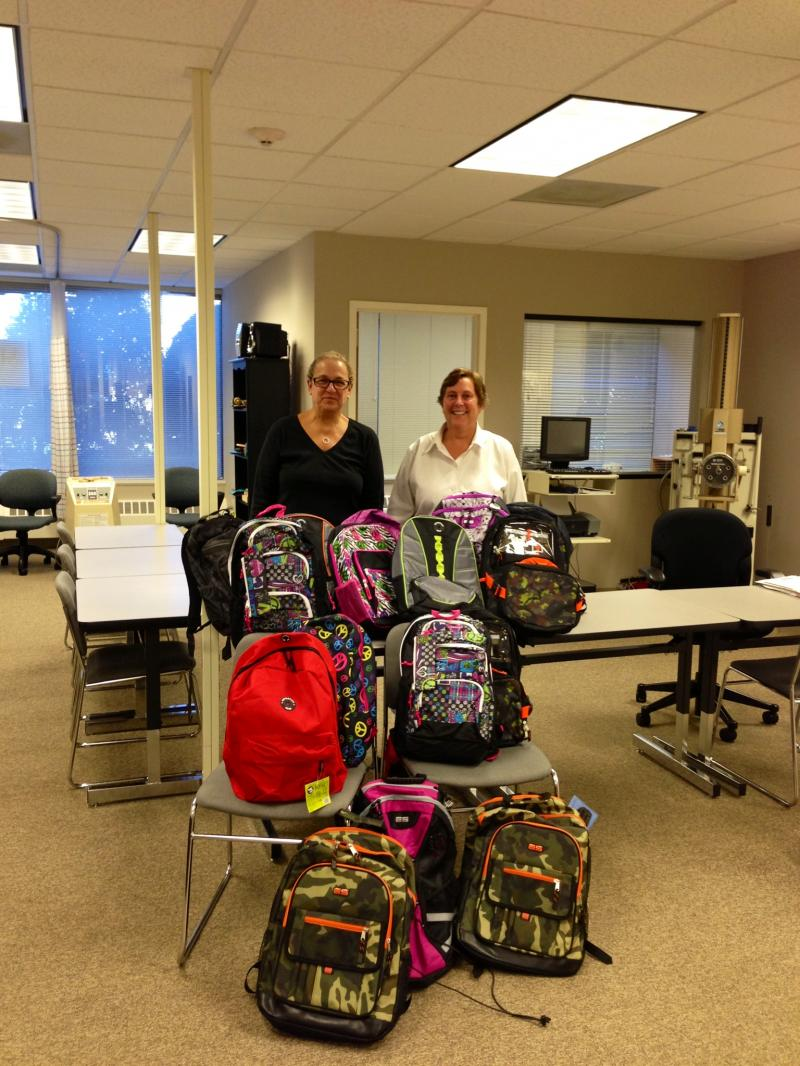 Sally, Kathy, and a pile of filled backpacks!